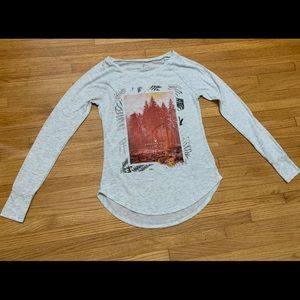 White long sleeve shirt with nature pattern on top